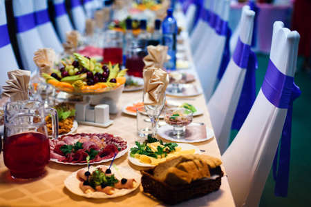 festive table in the restaurant with plates, glasses and Cutlery on a white tablecloth Stock fotó