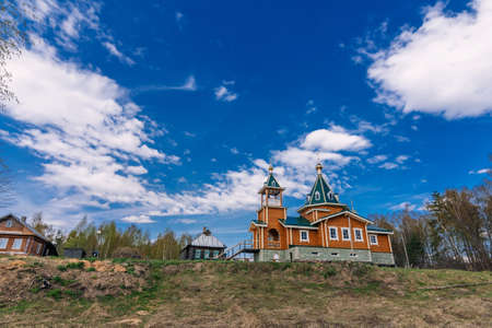 Orthodox Christian modern wooden Church in a village in Russia on a summer day 免版税图像