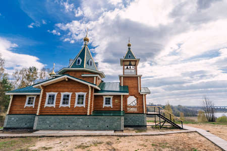 Orthodox Christian modern wooden Church on the river Bank in Russia on a summer