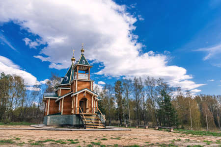 modern wooden Church of the Christian Orthodox religion in the nature in the forest