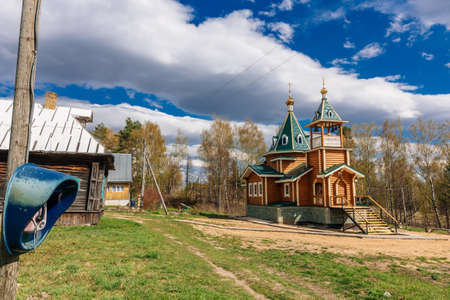 Orthodox Christian modern wooden Church in the village near the forest