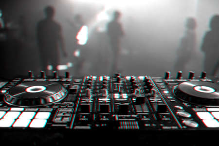 DJ mixer on the table background the night club