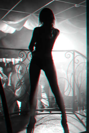 silhouette of a young slim sexy girl in nightclub