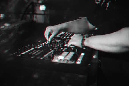 DJ plays on music mixer in a nightclub Stock fotó