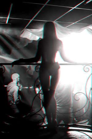 silhouette of sexy slender girl on the dance floor of night club posing Stock fotó