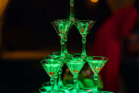 glasses with Martini cocktail, with sweet cherry on the restaurant bar