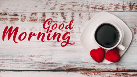 Greeting card with the inscription Good morning. Cup of coffee on a white wooden table