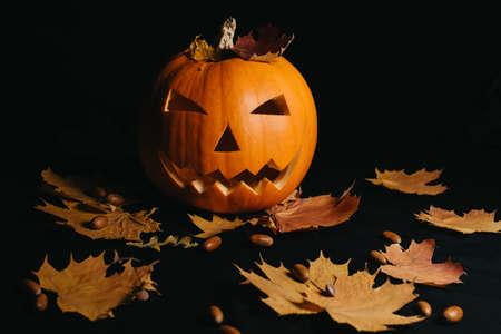 Halloween pumpkin with orange maple leaves and acorns Banco de Imagens
