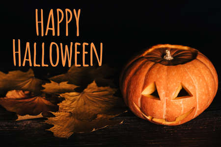 greeting card with text for Halloween celebration with orange pumpkin