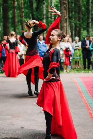 VICHUGA, RUSSIA - JUNE 11, 2016: Girls dancing flamenco dance in red black dresses on the day of Vichuga