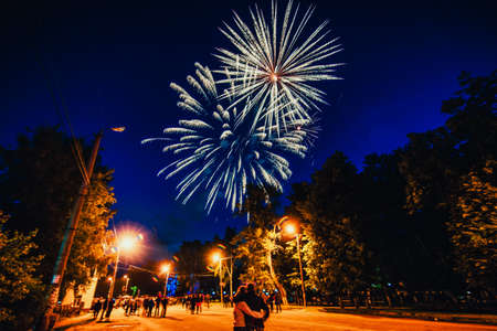 VICHUGA, RUSSIA - JUNE 24, 2017: Festive fireworks and a crowd of people at the Festival of the Day of Vichuga