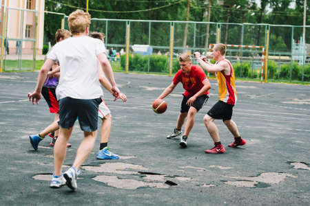 VICHUGA, RUSSIA - JUNE 11, 2016: Teenagers playing streetball on the celebration of the city of Vichuga Editorial
