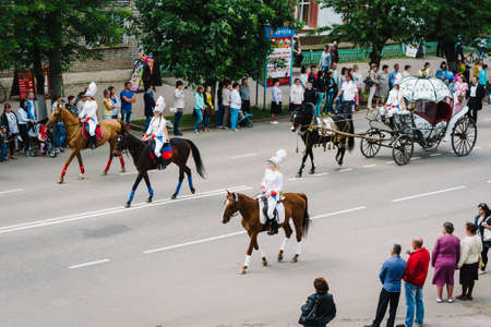 VICHUGA, RUSSIA - JUNE 11, 2016: A crowd of people walking down the street in celebration of the city day Vichuga