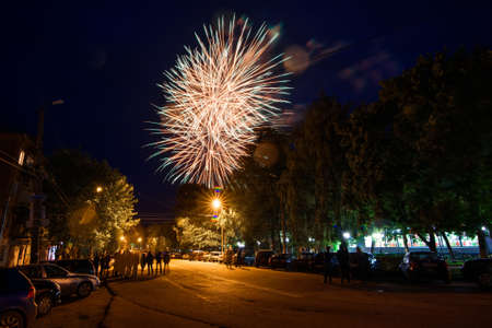 VICHUGA, RUSSIA - JUNE 11, 2016: Colorful explosions of fireworks in the night against the sky on the celebration of the city of Vichuga Editorial