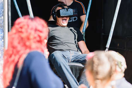 LUH, RUSSIA - AUGUST 27, 2016: Emotional adult man in virtual reality glasses Editorial