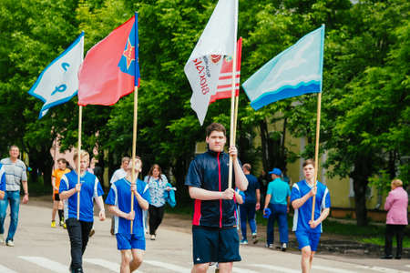 VICHUGA, RUSSIA - JUNE 24, 2017: Festive procession of people on the street on the Day of Vichuga
