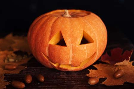 pumpkin for Halloween with autumn orange maple leaves and acorns Banco de Imagens