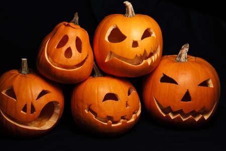 festive autumn card with orange pumpkins. Jacks lantern on Halloween celebration