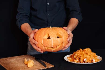 pumpkin for Halloween in the hands of men Banco de Imagens