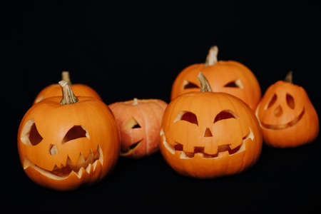 decorative orange Halloween pumpkins with carved faces
