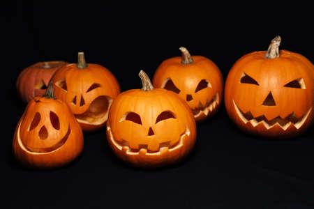 orange pumpkins with carved faces for Halloween celebration. Jacks lantern