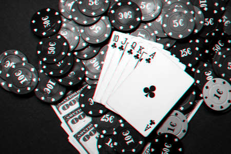 Winning combination of cards in casino poker. Royal flush, a bunch of chips and money dollars