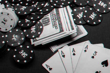 winning combination of cards in poker on the background of money and game chips