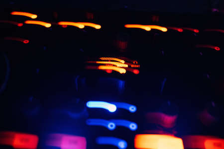 glowing lights from DJ mixer music remote
