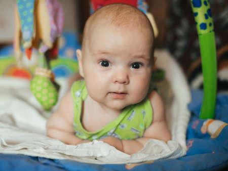 portrait of lying funny Caucasian baby boy