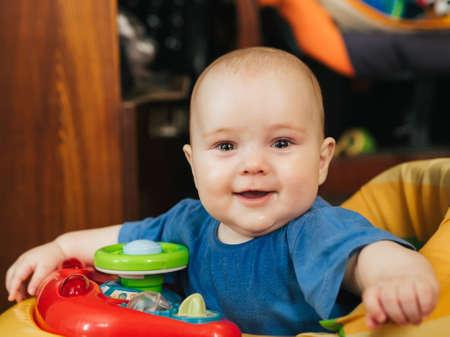 portrait of a cute Caucasian baby boy in a Walker Stok Fotoğraf