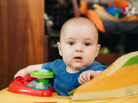 cute Caucasian boy infant baby in Walker