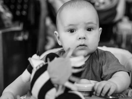 black and white close up portrait of baby boy in Walker