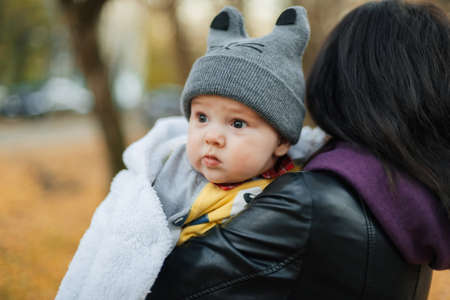 young beautiful Caucasian girl mom holding her little boy baby son Stok Fotoğraf