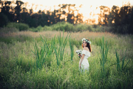 happy girl in a white dress and a bouquet of flowers smiles and joy Stok Fotoğraf