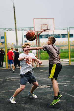 VICHUGA, RUSSIA - JUNE 11, 2016: Teenagers playing streetball on the celebration of the city of Vichuga Editöryel