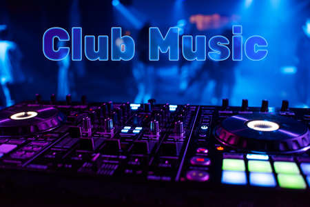 Inscription Club Music on the background of the dj mixer