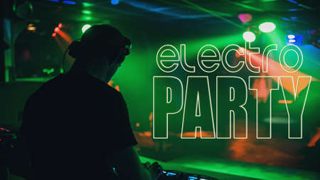 inscription Electro Party on the background of a DJ mixing music Banco de Imagens