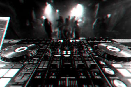 professional DJ mixer controller for mixing music in a nightclub Banco de Imagens
