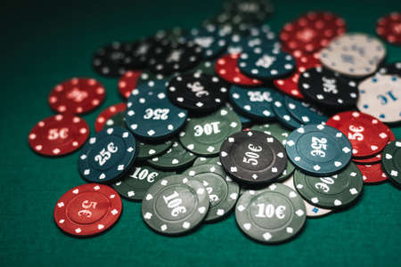 jackpot of poker chips on the green table close-up Banco de Imagens