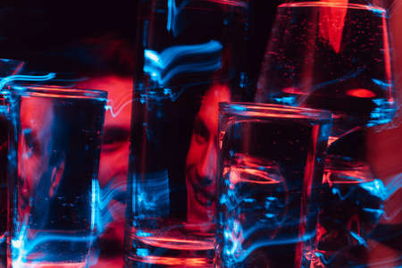 psychedelic portrait of a mad psychopath male schizophrenic through glasses of water Stockfoto
