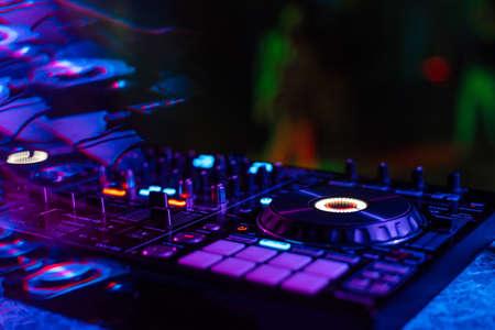 music mixer DJ controller in booth at nightclub