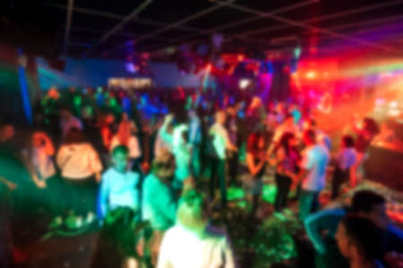 blurred silhouettes of people dancing in a nightclub Banco de Imagens