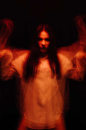 blurry portrait of a psychopathic girl with schizophrenic mental disorders Фото со стока