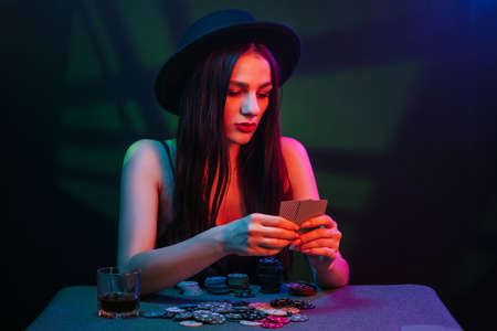 poker player at a casino table with cards and chips Фото со стока