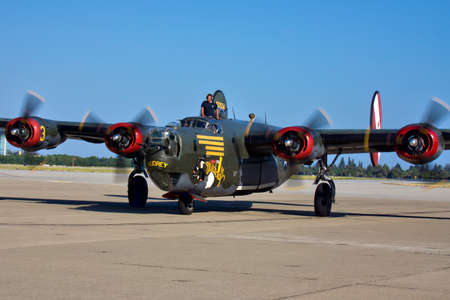 liberator: New pilots generation proudly leading B-24 Liberator WWII veteran aircraft on Moffett Field air show Editorial