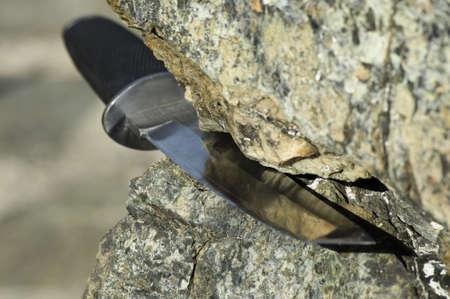 Tanto knife stuck in rock Stock Photo