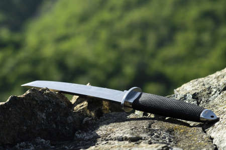 Tanto knife on rock