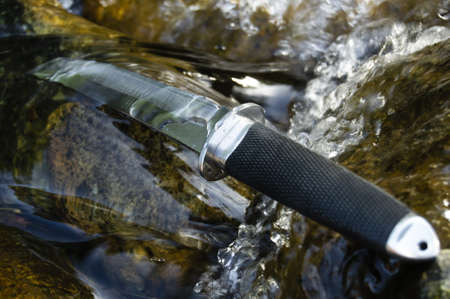 strenght: Tanto knife in water Stock Photo