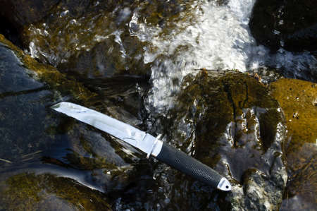 wakizashi: Tanto knife in water Stock Photo