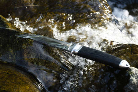 Tanto knife in water Stock Photo